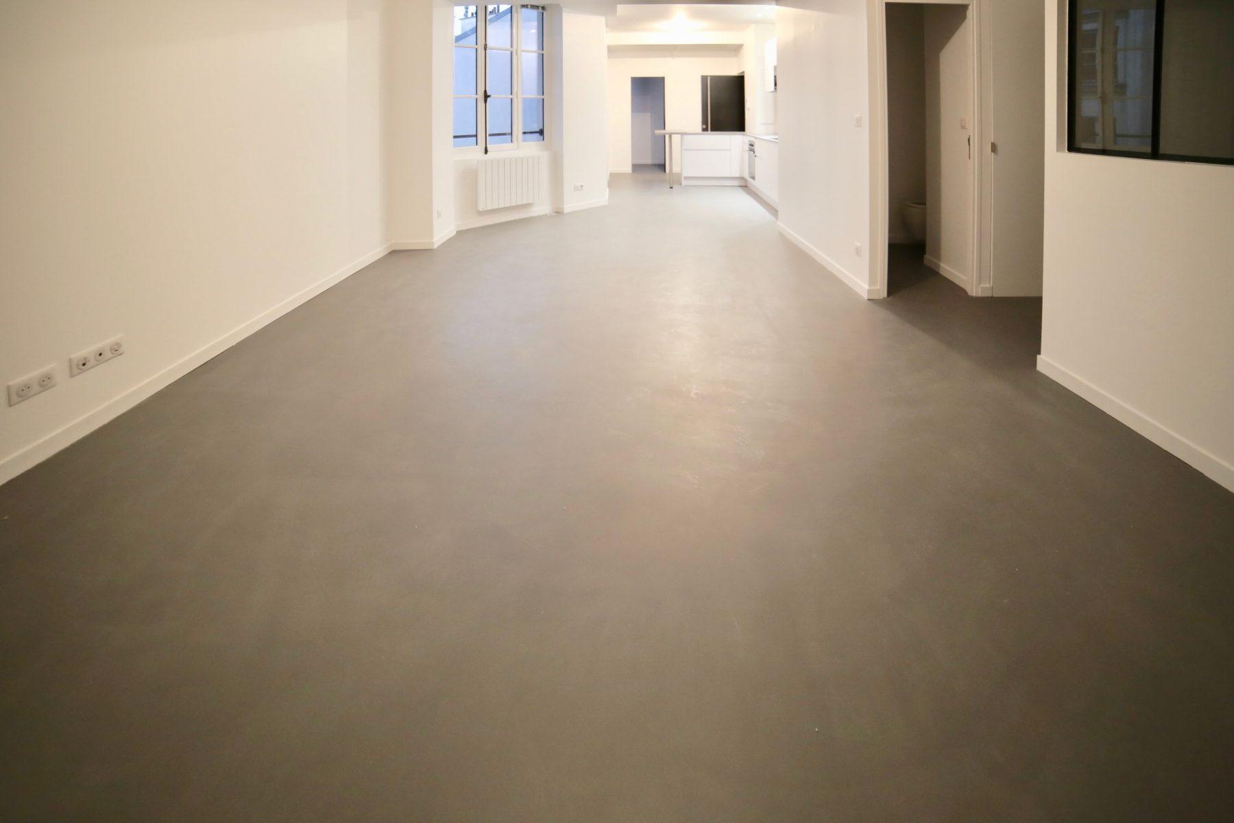 Béton ciré taloché appartement privé Décaum Paris 11