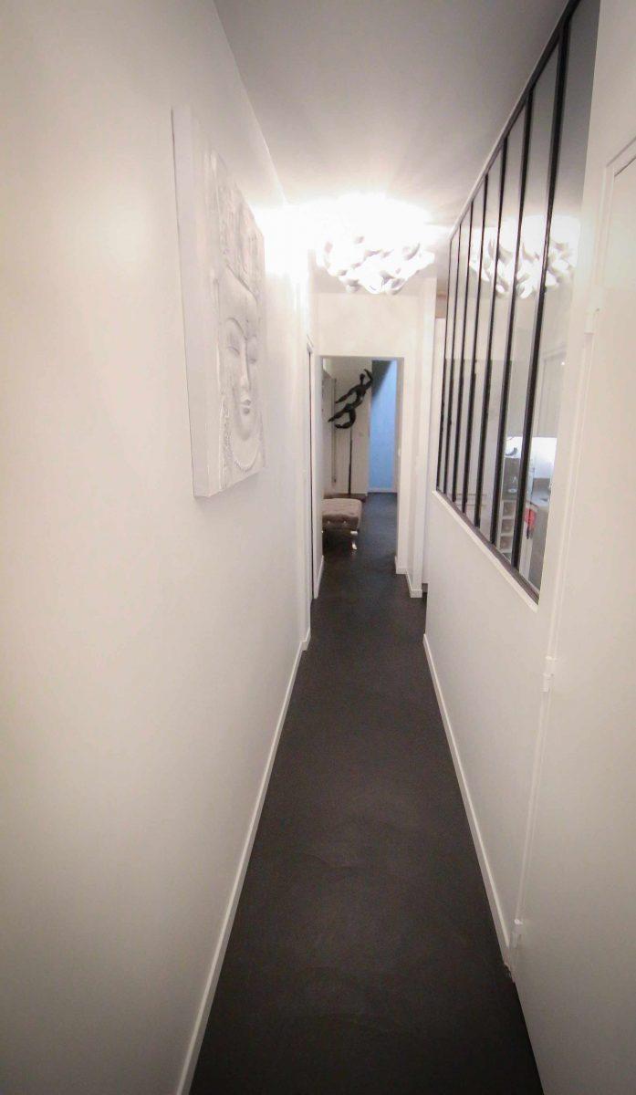 Couloir béton ciré spatulé appartement Décaum Paris 15